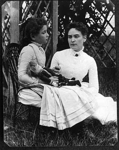 """Helen Keller with Anne Sullivan in July 1888"" by Family member of Thaxter P. Spencer, now part of the R. Stanton Avery Special Collections, at the New England Historic Genealogical Society. See Press Release [1] for more information. - New England Historic Genealogical Society. Licensed under Public Domain via Commons - https://commons.wikimedia.org/wiki/File:Helen_Keller_with_Anne_Sullivan_in_July_1888.jpg#/media/File:Helen_Keller_with_Anne_Sullivan_in_July_1888.jpg"